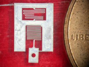 This micro G-force sensor was cut from 25 μm thick aluminum.