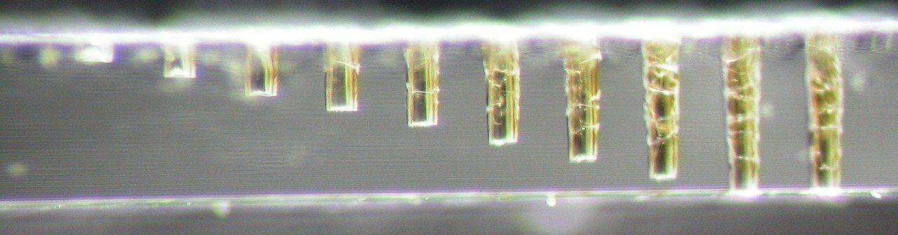Micro-drilling glass